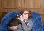 woman in armchair with cat