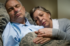 woman cuddling sick man