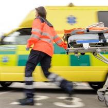 running paramedic with stretcher