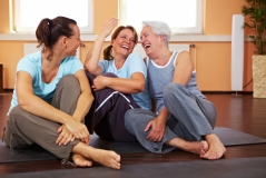 women laughing together after exercise