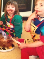 children licking cake mix from a bowl