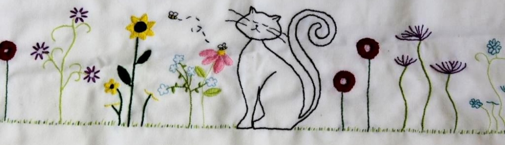 embroidered napkin with cats and flowers