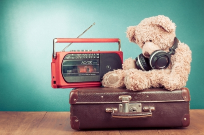 teddy with headphones, radio and suitcase