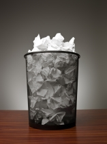 waste basket with paper in