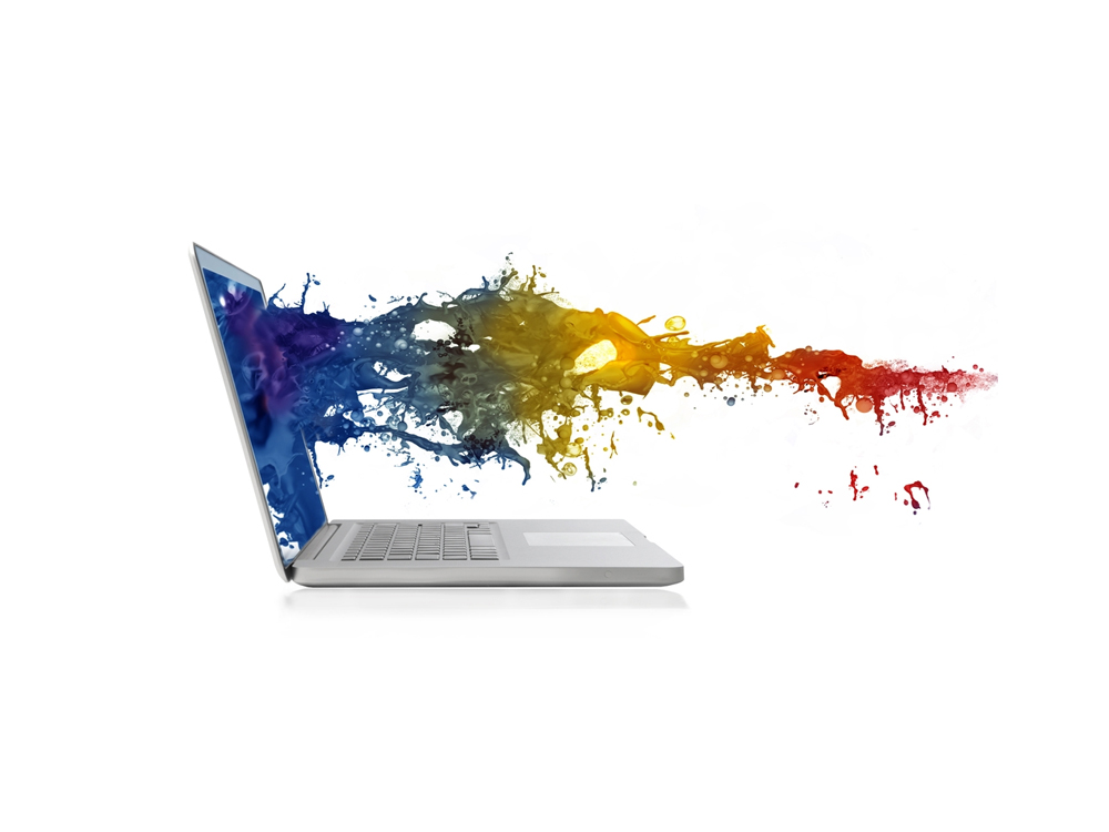 laptop with coloured ink coming out